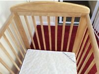 Wooden babys cot with mattress, from a smoke free and pet free home