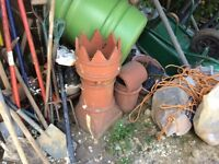 Clay chimney pot with bonnet