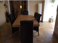 Oak dining table and 6 dark brown leather chairs for sale. £200