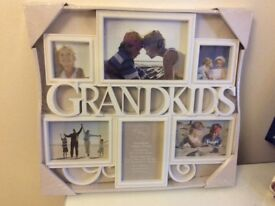 "Brand new ""Grandkids"" multi photo frame. Still in original packaging."