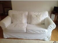 Two white sofas in very good condition. Removable covers. Spare set beige covers.
