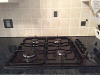 Built in New World gas oven and Carrera hob