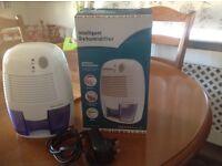 Compact air dehumidifier comes boxed