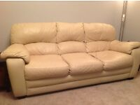 Cream leather sofas and matching armchair
