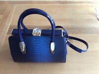 Blue Handbag with Jewel Clasp