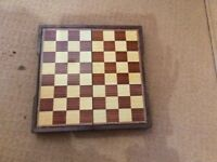 Magnetic travel chess-draughts set
