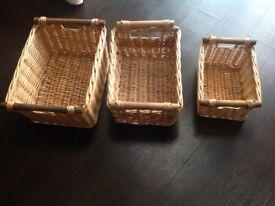 Three wicker storage baskets