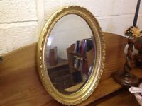 Pretty oval bevelled mirror