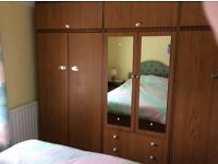 3 piece wardrobe with shelving and overhead cupboards