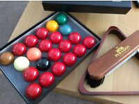 Box of snooker balls with triangle and brush