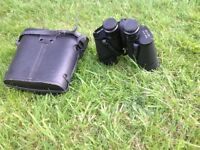 Mark Scheffel Binoculars 20x50 coated optics,lens caps,lanyard straps and its case.