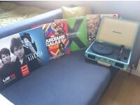 portable record player in case with records inc Ed Sheeran