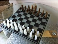 Chess set. marble figures. Glass board.