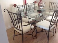 Glass dining table with cast iron legs, six chairs and matching console table