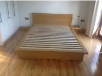 Next Wood double bed with four drawers and bedside table