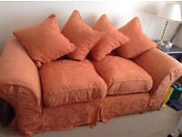 Two identical 2 sweeter sofas plus a matching footstool