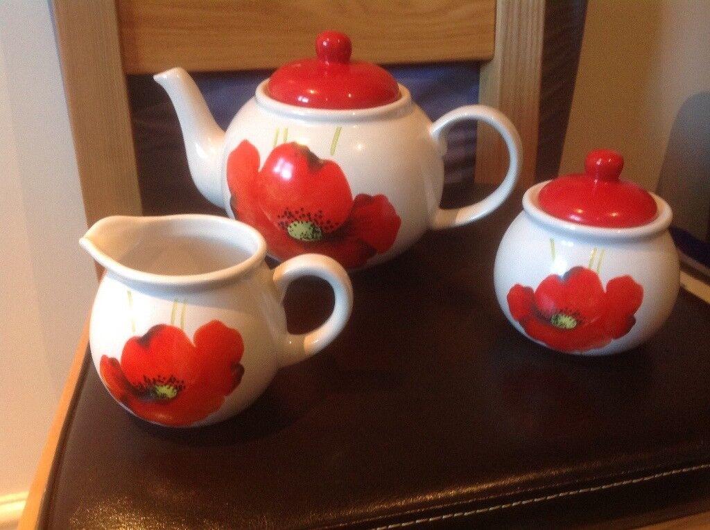 Teapot, milk jug, sugar bowl