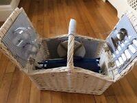 White wicker picnic hamper with picnic rug and accessories