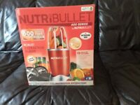Nutribullet 600 series , red in colour, never opened so perfect condition