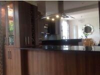 Complete Kitchen. Includes double CDA oven, induction hob, microwave, fridge freezer , cooker hood.