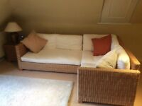 Rattan corner sofa unit with small side table
