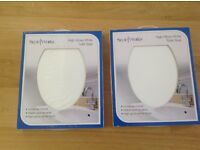 Pair of brand new sealed and boxed white toilet seats