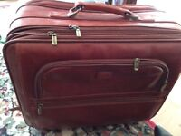 Condotti pull along Leather overnight case with sections for laptop/files etc.