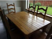 Solid , heavy , varnished oak table and 6 chairs.