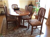 Wood dining table with 6 chairs. Chairs needs upholstering. In very good condition