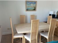 Elegant marble topped table and 6 contemporary wooden chairs from Furniture Village