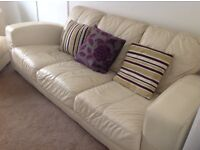 Three seater , two seater sofa and foot rest in cream leather