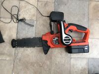 Black and decker ... battery operated power tool .. chainsaw