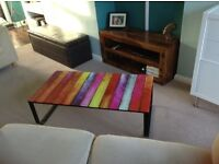 Glass topped coffee table with stripes