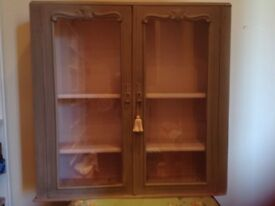 Vintage painted wood cabinet. Glass doors with lock. 2 internal,shelves.