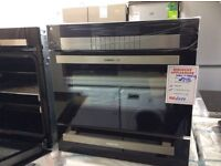 Electric oven and seperate warming drawer new /graded 12 mth gtee