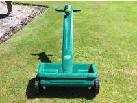 J Arthur Bower's lawn spreader. Excellent condition