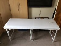 Massage table,strong and sturdy,fitted sheet with cut out included and carrying case.