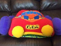 K's Kids sit in car