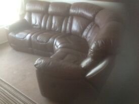 2 year old 4 seater reclining leather sofa.