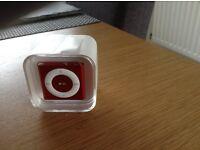 iPod shuffle 2GB brand new unopened Red, unwanted gift