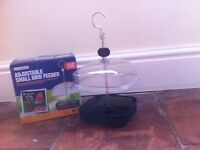 Bird feeder, new boxed. Adjustable basket type with cover