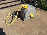 Hozelock 2 in 1 wind up 25m hose reel. Wall mounted or portable. Not automatic rewind.
