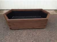 Long soft wood lined planter