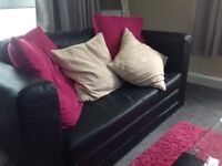 IKEA sofa black look at like leather pulls out to bed