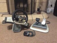 Steering wheel and pedal for Xbox 360.
