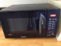 Black Samsung Trio combination, oven, grill and microwave, was £350 new will accept £100 ono