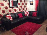 Black leather corner sofa - excellent condition