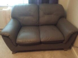 Slate grey leather two seater sofa