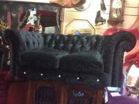 Black 2 seater crushed velvet Chesterfield sofa