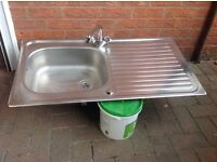 Stainless Steel Sink and Tap.